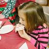 JOED VIERA/STAFF PHOTOGRAPHER-Lockport, NY-Emma Philbrick 5 eats a  cookie she decorated at Barker Chocolate Box. Saturday, November, 29, 2014.