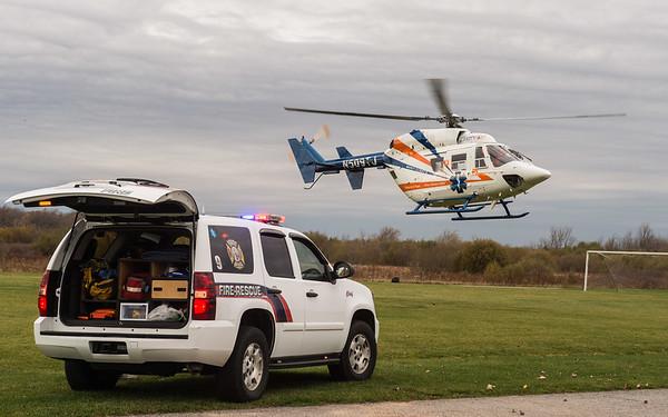 JOED VIERA/STAFF PHOTOGRAPHER-Lockport, NY-Mercy Flight lands at Day Park to address a medical emergency Tuesday, November, 4 2014.