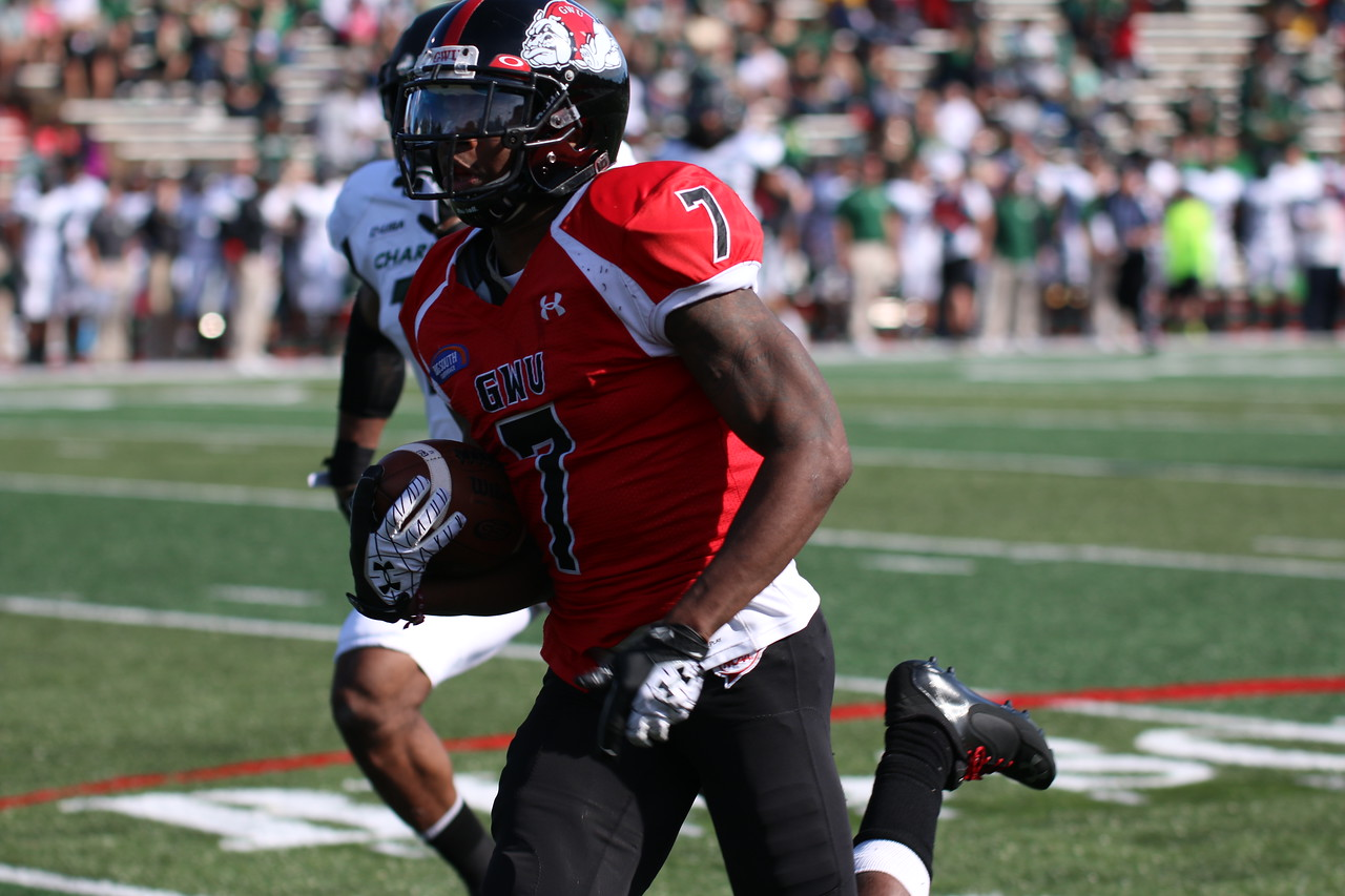 Football team squeezes past Charlotte for a 27-24 win for Homecoming.