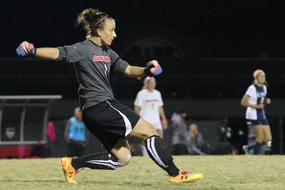 Goal Keeper, Krista Chauvin kicks the ball.