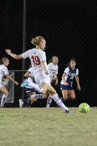 19, Jessica Casper kicks the ball.