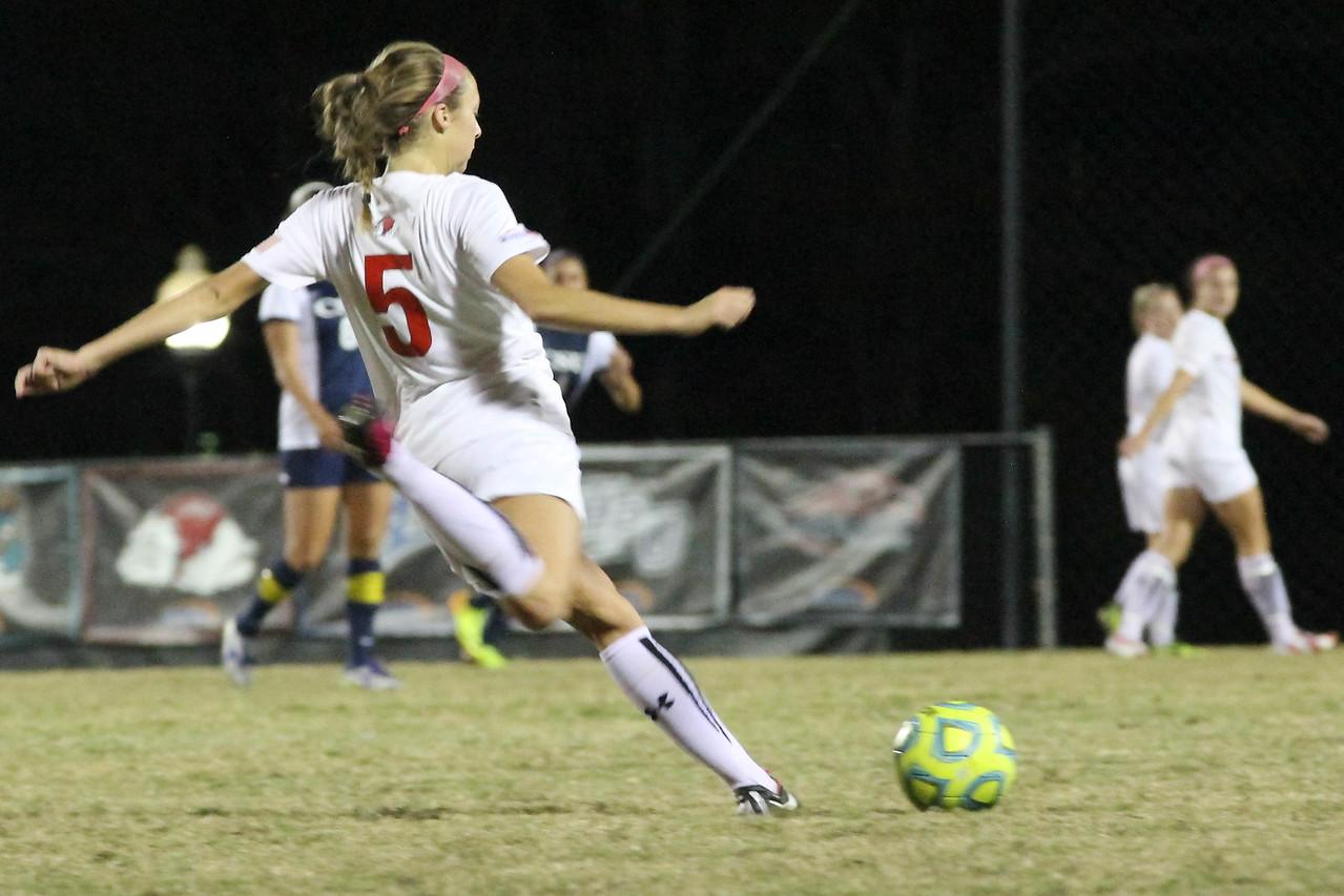 Number 5, Brianna Nagel kicks the ball.