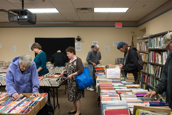 JOED VIERA/STAFF PHOTOGRAPHER-Lockport, NY-A packed crowd browses through stacks of books for sale at the Friends of Lockport Public Library book sale. Thursday, October, 16 2014.