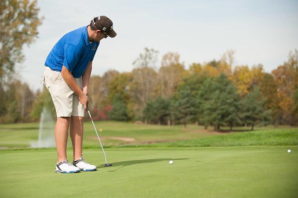 JOED VIERA/STAFF PHOTOGRAPHER-Lockport, NY-Evan Williams a Senior at Lockport High School golfs at the Niagara Frontier League Golf Tournament. Tuesday, October, 14 2014.