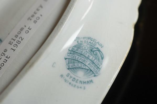 JOED VIERA/STAFF PHOTOGRAPHER-Middleport, NY-Pottery sent to Middleport from Middleport Pottery in England sits on a shelf at the Middleport Historical Society. Thursday, October, 9, 2014.