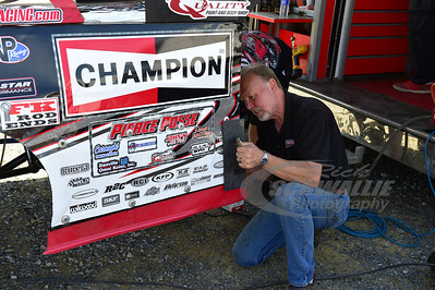 Bob Pierce works on his son, Bobby's car.