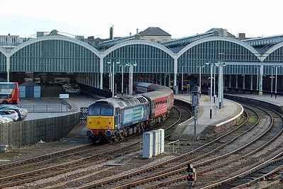 Paragon station's overall roof forms the impressive backdrop as 47853 'Rail Express' waits to work the 1Z71 1534 return leg to London later that afternoon (11/01/2014)