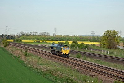 Running as 0N51 1645 York Yard to Leeds Balm Road, 66546 blends nicely into the landscape as it passes Burton Salmon (03/05/2014)
