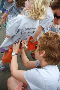 The number of laps each kid completed was recorded on the backs of their tshirts. Amelia ran 6 laps - about 1.5 miles.