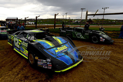 Jason Hughes and Scott Bloomquist look to hot lap as storms rolled in.