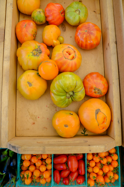 A variety of tomatos being sold at the Farmer's Market. (Nathan DeHart-Ukiah Daily Journal)