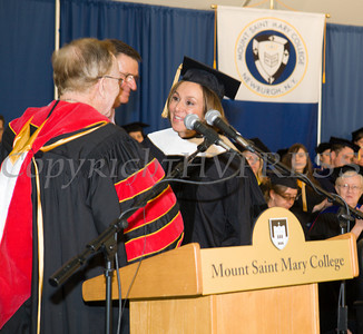 Fr. Kevin Mackin confers Doctor of Letters, honoris causa, to Rosanna Scotto during Mount Saint Mary College's 51st Commencement Exercises in Newburgh, NY on Saturday, May 17, 2014. Hudson Valley Press/CHUCK STEWART, JR.