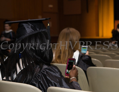 Students check their cell phones as they wait for Mount Saint Mary College's 51st Commencement Exercises for the graduating Class of 2014 in Newburgh, NY on Saturday, May 17, 2014. 498 undergraduates and 120 graduate students received their degrees. Hudson Valley Press/CHUCK STEWART, JR.