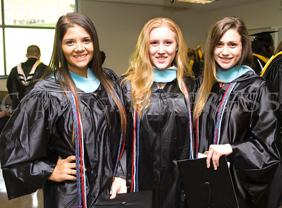 Cynthia Brescia, Caitlin Connor and Nicole Allen await to receive their Bachelor of Science in Education during Mount Saint Mary College's 51st Commencement Exercises in Newburgh, NY on Saturday, May 17, 2014. Hudson Valley Press/CHUCK STEWART, JR.