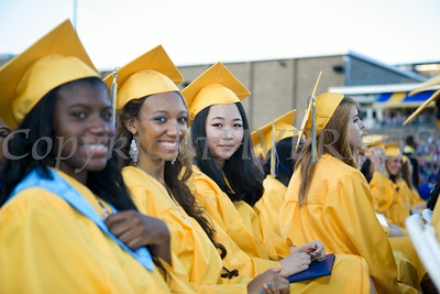 Seniors are all smiles after receiving their diplomas during Newburgh Free Academy's 149th Commencement Exercises for the graduating Class of 2014 on Academy Field in the City of Newburgh, NY on Thursday, June 26, 2014. Hudson Valley Press/CHUCK STEWART, JR.