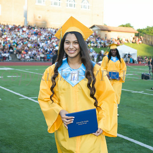 Newburgh Free Academy senior Cinthia Cordoba receives her diploma during NFA's 149th Commencement Exercises for the graduating Class of 2014 on Thursday, June 26, 2014 in Newburgh, NY. Hudson Valley Press/CHUCK STEWART, JR.