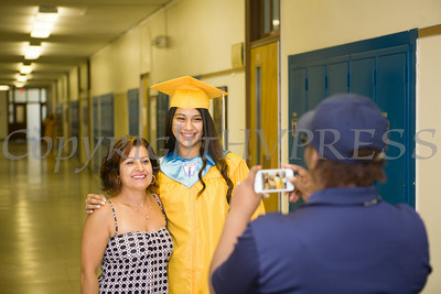 Newburgh Free Academy senior Cinthia Cordoba has her picture taken with teacher Maria Lastowski prior to NFa's 149th Commencement Exercises for the graduating Class of 2014 on Academy Field in the City of Newburgh, NY on Thursday, June 26, 2014. Hudson Valley Press/CHUCK STEWART, JR.