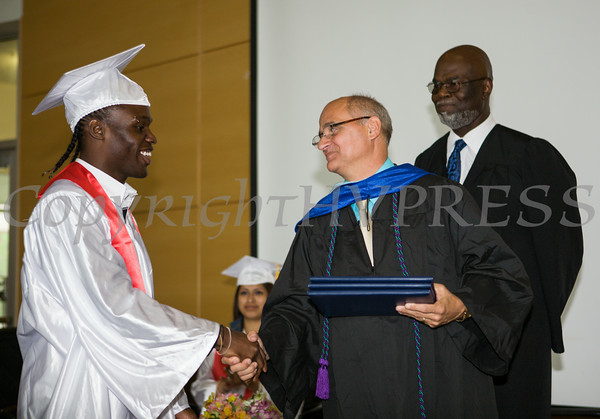 Newburgh Preparatory Charter H.S. senior Tyron Carter receives his diploma during the schools 1st Commencement Exercises for the graduating Class of 2014 in Newburgh, NY on Wednesday, June 25, 2014. Hudson Valley Press/CHUCK STEWART, JR.