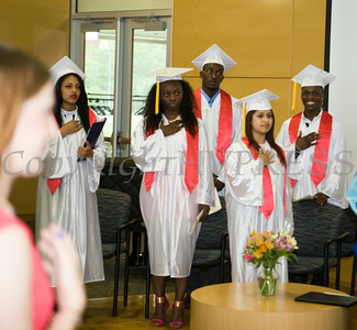 Newburgh Preparatory Charter H.S. seniors Carolina Sotomayor, Sade Young, Jovon Burks, Andrea Rosales and Tyron Carter say the Pledge of Allegiance during the schools 1st Commencement Exercises for the graduating Class of 2014 in Newburgh, NY on Wednesday, June 25, 2014. Hudson Valley Press/CHUCK STEWART, JR.