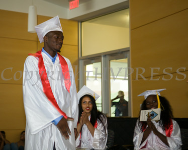 Newburgh Preparatory Charter H.S. senior Jovon Burks receives his diploma during the schools 1st Commencement Exercises for the graduating Class of 2014 in Newburgh, NY on Wednesday, June 25, 2014. Hudson Valley Press/CHUCK STEWART, JR.
