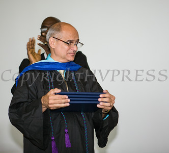 Newburgh Preparatory Charter H.S. Direcotr of Operations and Finance Russ Gilmore presents diplomas during the schools 1st Commencement Exercises for the graduating Class of 2014 in Newburgh, NY on Wednesday, June 25, 2014. Hudson Valley Press/CHUCK STEWART, JR.