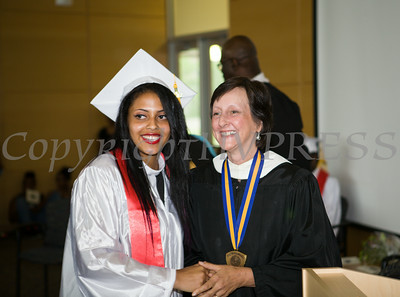 Newburgh Preparatory Charter H.S. senior Carolina Sotomayor receives her diploma during the schools 1st Commencement Exercises for the graduating Class of 2014 in Newburgh, NY on Wednesday, June 25, 2014. Hudson Valley Press/CHUCK STEWART, JR.