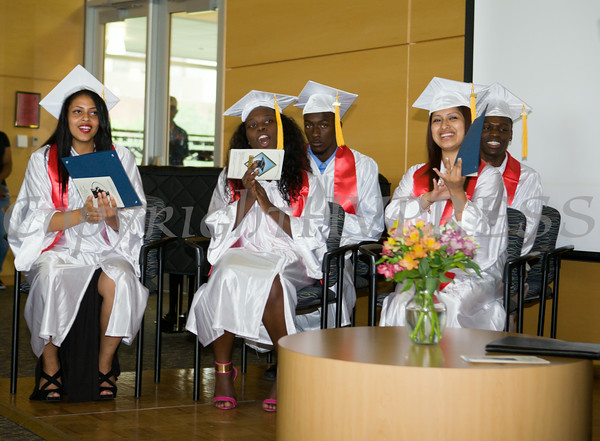 Newburgh Preparatory Charter H.S. seniors Carolina Sotomayor, Sade Young, Jovon Burks, Andrea Rosales and Tyron Carter receive their diplomas during the schools 1st Commencement Exercises for the graduating Class of 2014 in Newburgh, NY on Wednesday, June 25, 2014. Hudson Valley Press/CHUCK STEWART, JR.