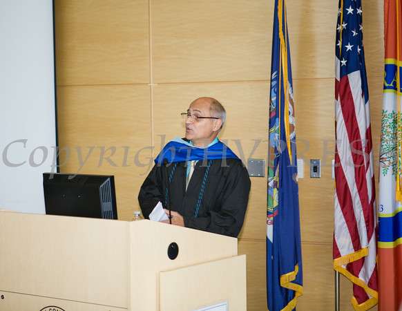 Newburgh Preparatory Charter H.S. Director of Operations & Finance Russ Gilmore offers remarks during the schools 1st Commencement Exercises for the graduating Class of 2014 in Newburgh, NY on Wednesday, June 25, 2014. Hudson Valley Press/CHUCK STEWART, JR.