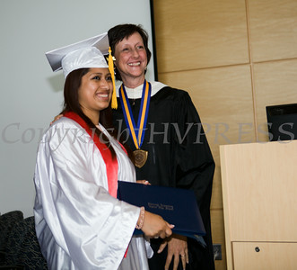 Newburgh Preparatory Charter H.S. senior Andrea Rosales receives her diploma during the schools 1st Commencement Exercises for the graduating Class of 2014 in Newburgh, NY on Wednesday, June 25, 2014. Hudson Valley Press/CHUCK STEWART, JR.