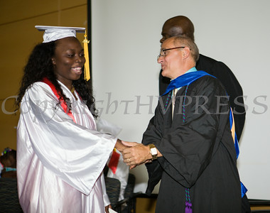 Newburgh Preparatory Charter H.S. senior Sade Young receives her diploma during the schools 1st Commencement Exercises for the graduating Class of 2014 in Newburgh, NY on Wednesday, June 25, 2014. Hudson Valley Press/CHUCK STEWART, JR.