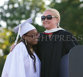 Poughkeepsie High School Senior Class Advisor Heather Martino and Class President Takiah Wiggins present the class gift during the school's 142nd Commencement Exercises on Friday, June 27, 2014 in Poughkeepsie, NY. Hudson Valley Press/CHUCK STEWART, JR.