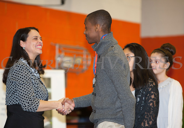 The Honorable Maria Vazquez-Doles shakes hands with Cornwall Central High School Honoree Joshua Yeadon at the 28th Annual Sojourner Truth Awards, held at SUNY Orange in Middletown, NY on Friday, March 14, 2014. Hudson Valley Press/CHUCK STEWART, JR.