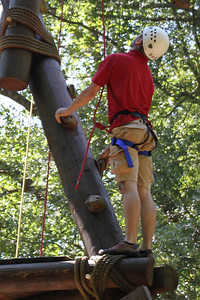 Students and their families enjoy climbing at the Broyhill Adventure Course during family weekend.