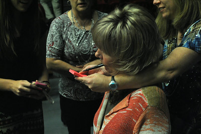 Joni Eareckson Tada signs autographs for community members and students after speaking at dimensions.
