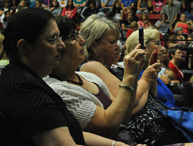 community members watch and take pictures of Joni Eareckson Tada as she speaks at dimensions on September 2nd.