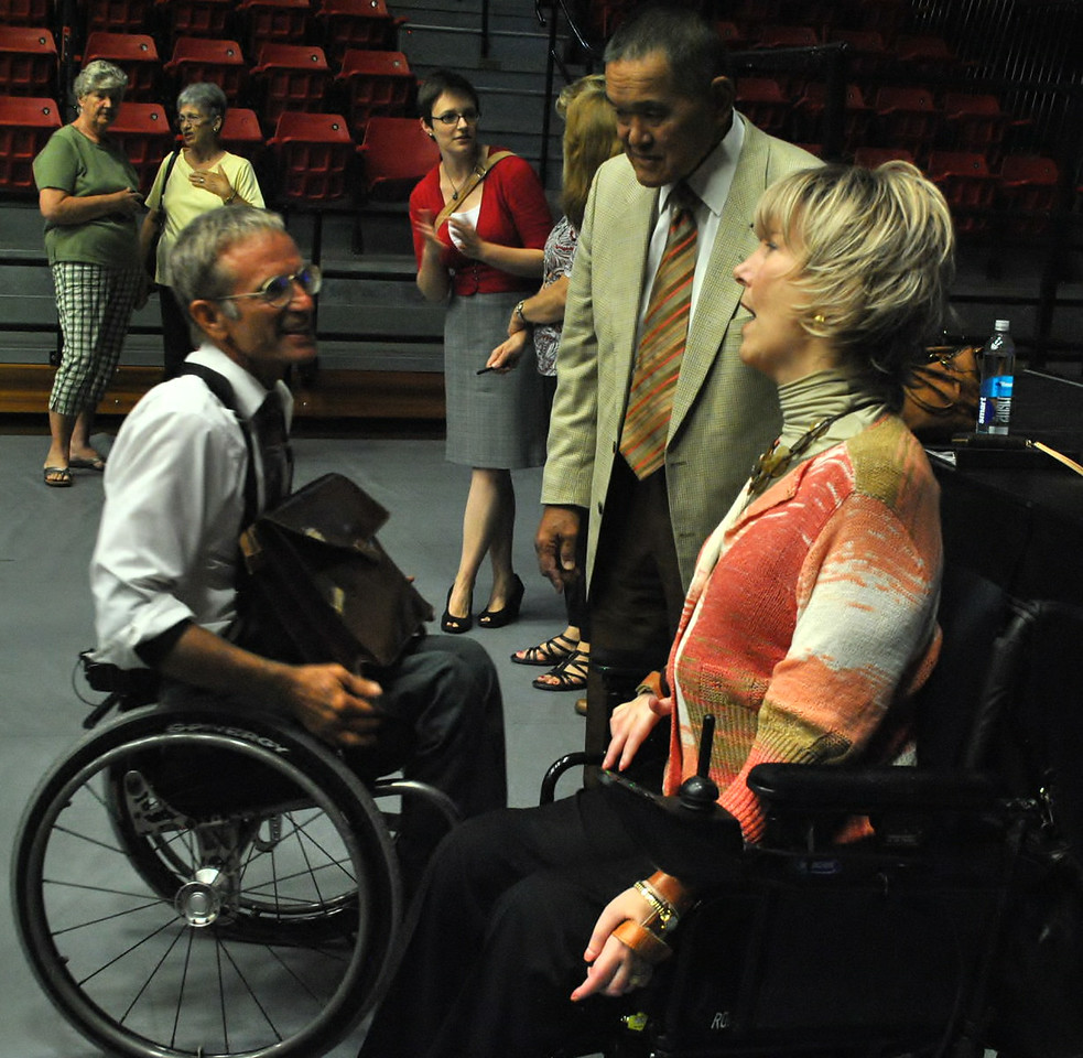 Joni Eareckson Tada talks with a community member after speaking at dimensions.