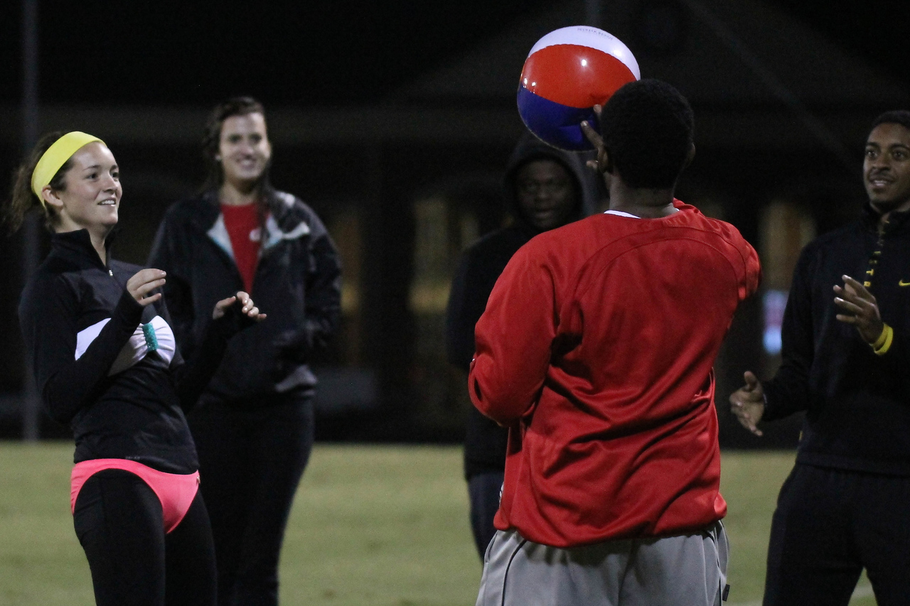 "Students compete in a fun game of ""hot potato"" on Beach Night at the soccer game."