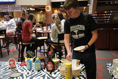 Students enjoy free pancakes from student activities.
