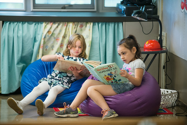 JOED VIERA/STAFF PHOTOGRAPHER-Lockport, NY-Roy B. Kelley Elemantary 1st graders read Alphabet books during the first day of school on Wednesday, September,3rd.