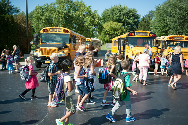 JOED VIERA/STAFF PHOTOGRAPHER-Wilson, NY-Wilson Elementary students walk to their buses after the first day of school on Wednesday, September,3rd.