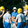 JOED VIERA/STAFF PHOTOGRAPHER-Lockport, NY-Varsity Lions listen as Coach gives a speech during practice on Monday, August 18th.