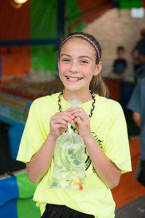 JOED VIERA/STAFF PHOTOGRAPHER-Wilson, NY-Kassidy Sidote shows off the goldfish she won at the fair on Thursday, August, 21st.