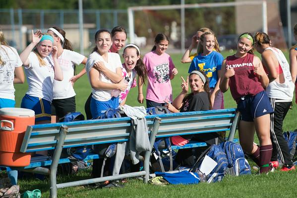 JOED VIERA/STAFF PHOTOGRAPHER-Lockport, NY-Lockport's Girls Varsity Soccer team fools around during practice on Monday, August 18th.