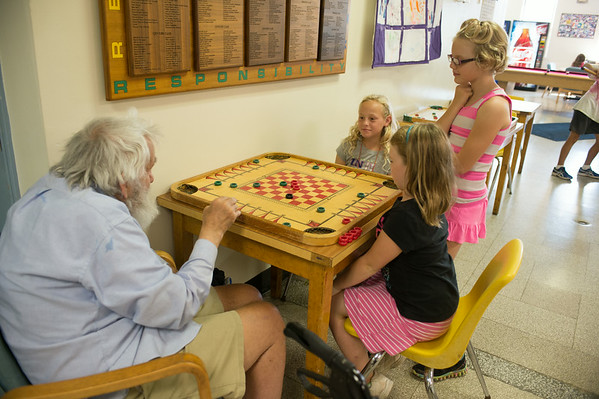 JOED VIERA/STAFF PHOTOGRAPHER-Lockport, NY-Goose Gray plays a game with Addyson Glor, Nadia Quader and Camryn Schiavitti during the YMCA's Daycamp on Tuesday, August, 26th.
