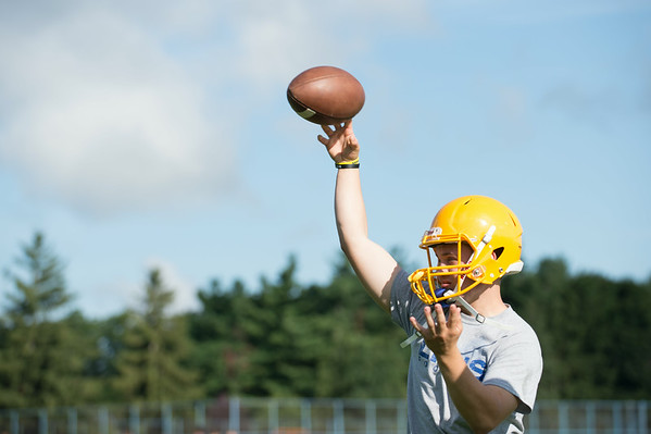 JOED VIERA/STAFF PHOTOGRAPHER-Lockport, NY-Quarterback Tyler Frost a Senior throws the ball during practice on Monday, August 18th.