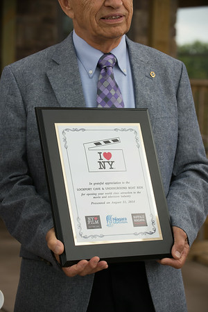 """JOED VIERA/STAFF PHOTOGRAPHER-Lockport, NY-holds an award given to  Lockport cave and underground boat ride which were featured in """"Sharknado 2"""" on Thursday, August, 21st."""