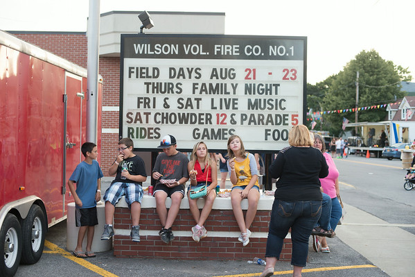 JOED VIERA/STAFF PHOTOGRAPHER-Wilson, NY-Kids enjoy fair food on the Wilson Vol. Fire Co. sign on  Thursday, August, 21st.