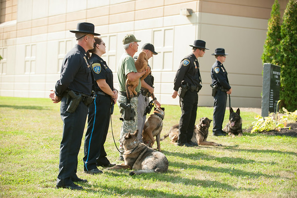 JOED VIERA/STAFF PHOTOGRAPHER-Lockport, NY-Deputies and their K9 partners attend the K9 Officer memorial ceremony at the Niagara County Sheriffs Office on Tuesday, August, 26th.