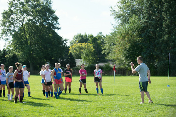 JOED VIERA/STAFF PHOTOGRAPHER-Lockport, NY-Lockport's Girls Varsity Soccer coach runs a drill during practice on Monday, August 18th.