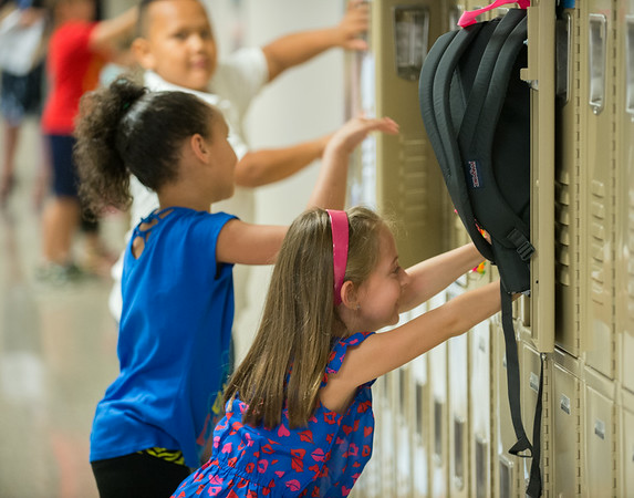 JOED VIERA/STAFF PHOTOGRAPHER-Lockport, NY-Roy B. Kelley Elementary students push backpacks into their lockers during first day of school on Wednesday, September,3rd.